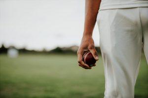 man holding a cricket ball